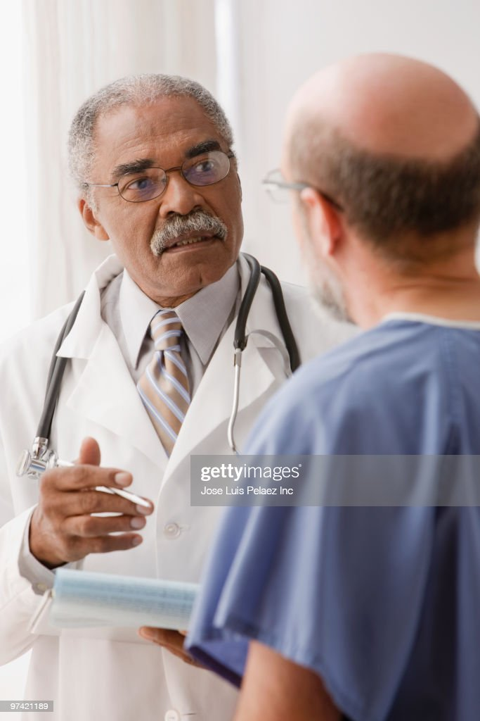 African doctor talking to patient : Stock Photo