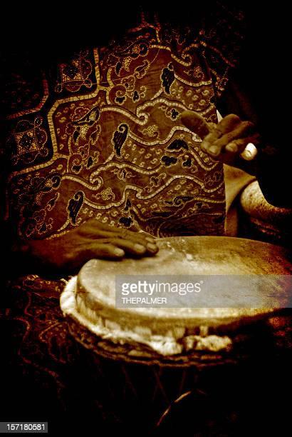 african drummer in dark sepia