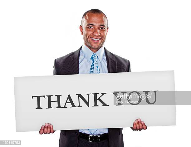 african, ethnic male holding thank you sign in suit