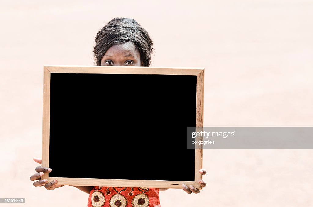 African Ethnicity Mature College Student Holding and Showing Blackboard (Mali) : Stock Photo