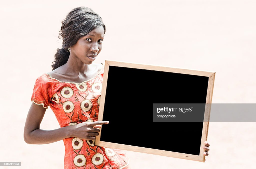 African Ethnicity Mature Student Showing and Pointing Blackboard Copy Space : Stock Photo