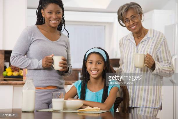 African family eating breakfast in kitchen