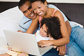 African family looking at laptop