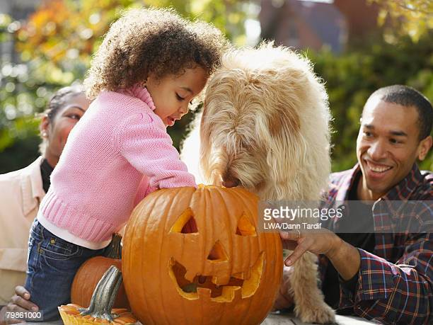 African family making jack-o-lantern
