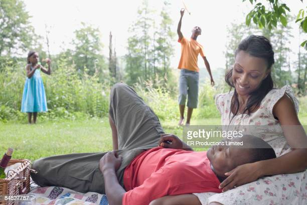 African family relaxing in park