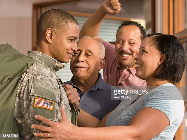 African family welcoming home soldier
