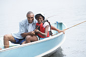 African father and daughter fishing