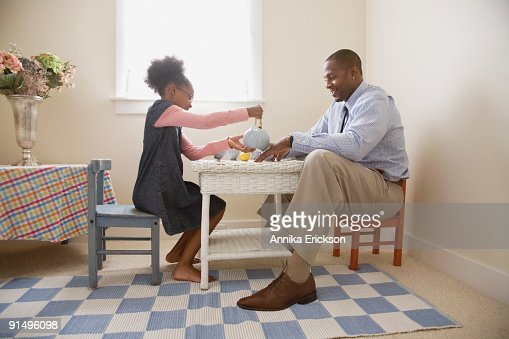 African father and daughter playing tea
