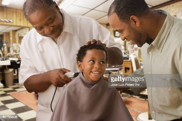 African father and son at barbershop