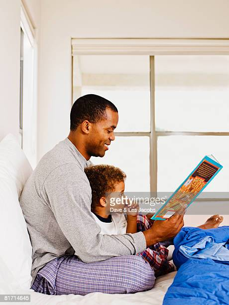 African father reading to son