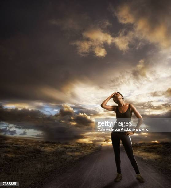 African female runner on remote road