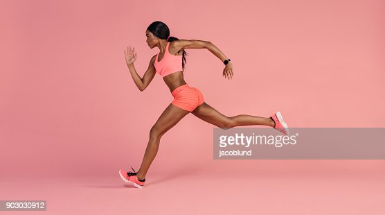 African female runner sprinting : Stock Photo