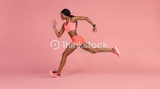 African female runner sprinting : Stock Photo