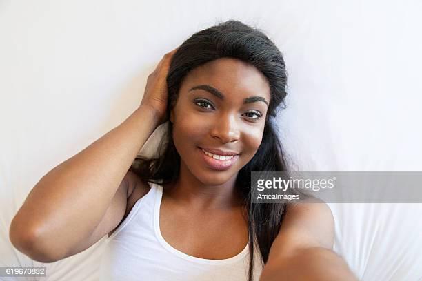 African female taking a selfie.