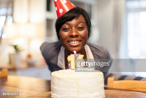 African Female Teenager Blowing Out The Candle On Her 16th ...