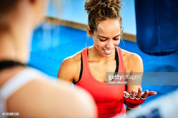 African female with boxing gloves in gym
