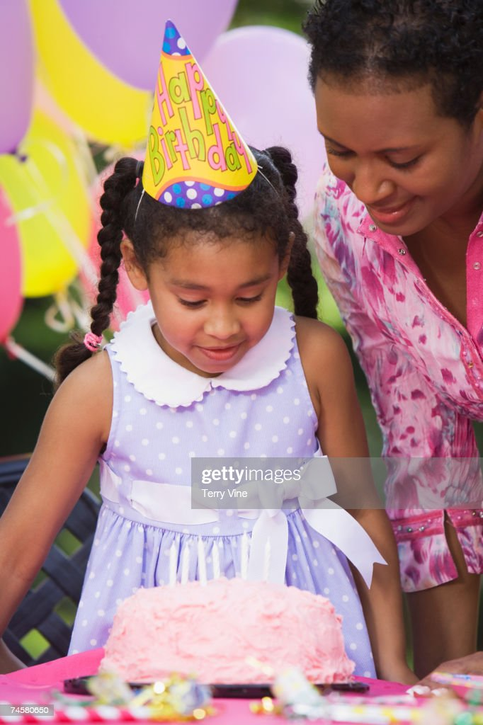 African girl and cake at birthday party : Stock Photo