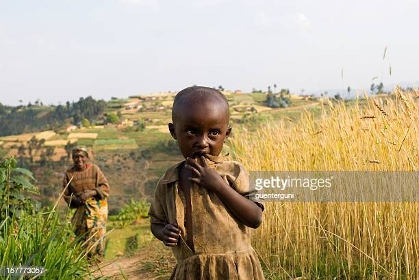 African girl and her mother in the fields of Rwanda