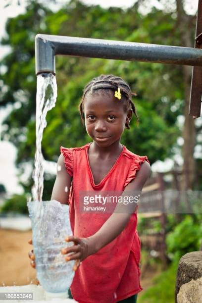African Girl By Water Pump