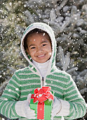 African girl holding gift in snow