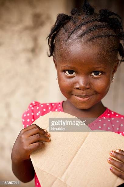 African Girl Holding Heart Shaped Sign