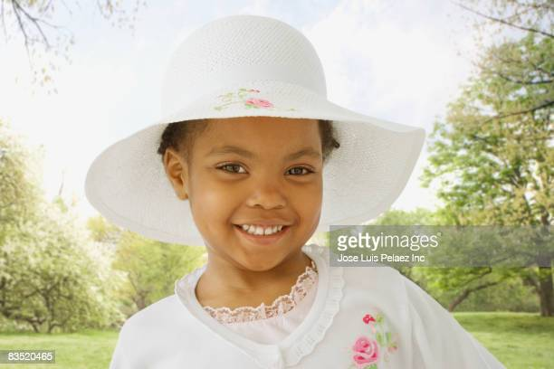 African girl in fancy dress and hat