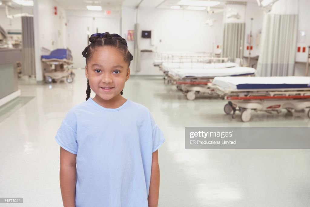 African girl in hospital gown in hospital