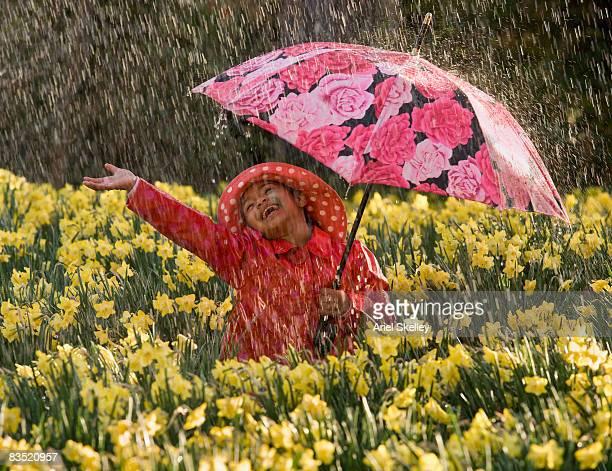 African girl playing in the rain