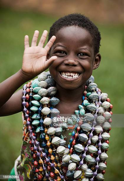 African girl waving