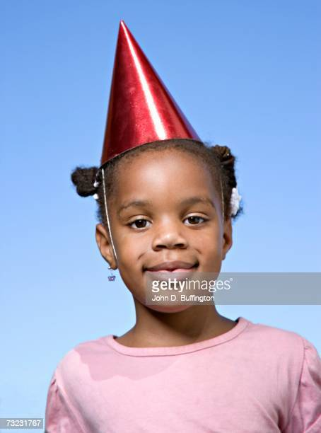 African girl wearing party hat outdoors
