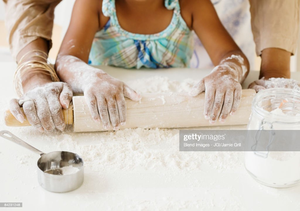 African grandmother baking with granddaughter