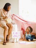African grandmother offering granddaughter lemonade