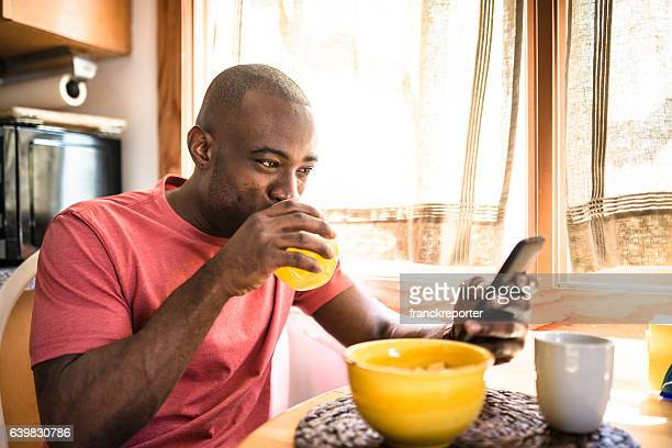african guy doing breakfast at home