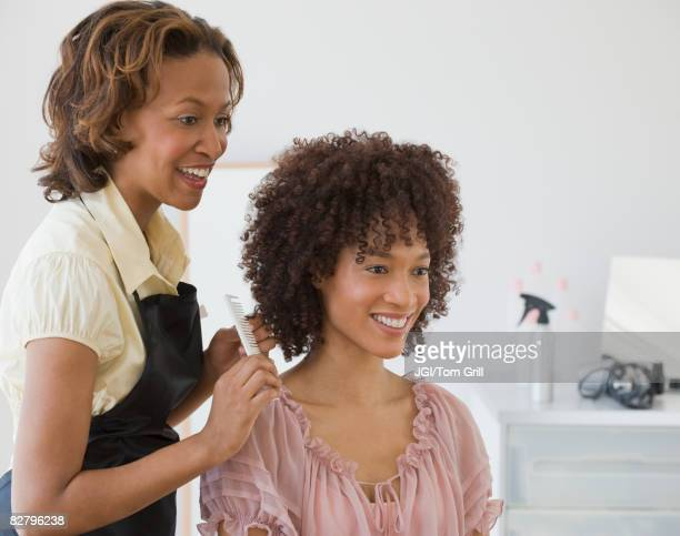 African hairdresser and client