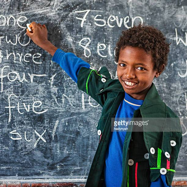 African little boy is learning English language