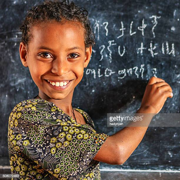 African little girl is learning Amharic language