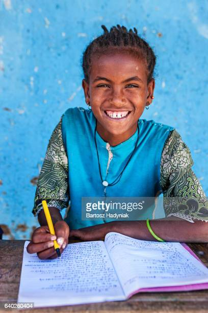 African little girl is learning English language