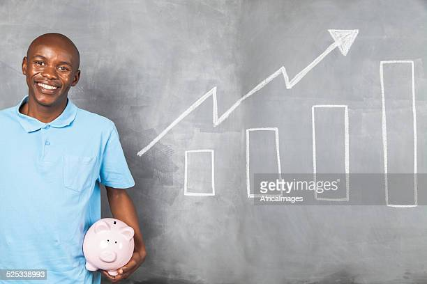 African male happy with the growth of his savings