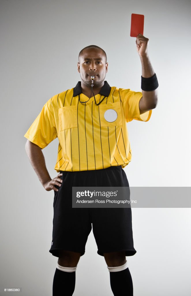 African male referee holding red card : Stock Photo