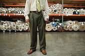 African male sales clerk in flooring warehouse