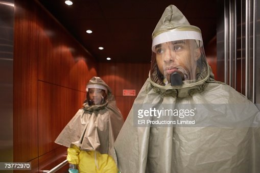 African man and woman in hazmat suits : Stock Photo