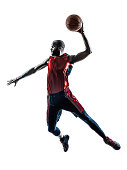 one african man basketball player jumping dunking in silhouette white background