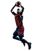 one african man basketball player jumping throwing in silhouette isolated white background
