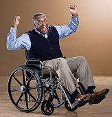 African man cheering in wheelchair