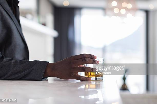 African man drinking whiskey, Cape Town, South Africa