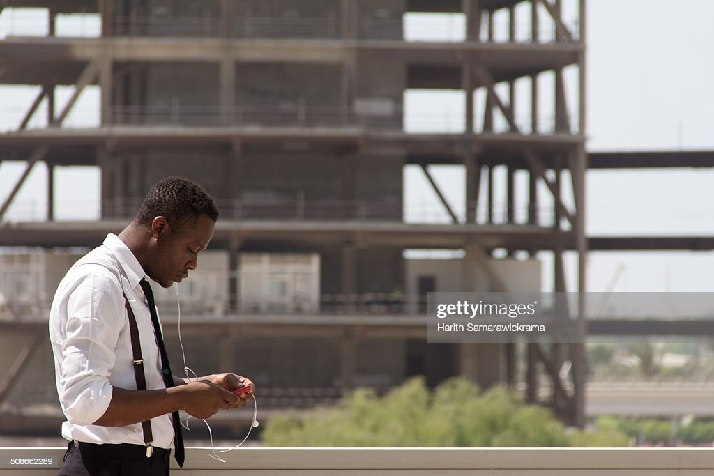 African man is checking his phablet