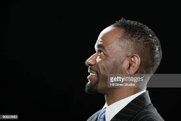 African man looking up and smiling
