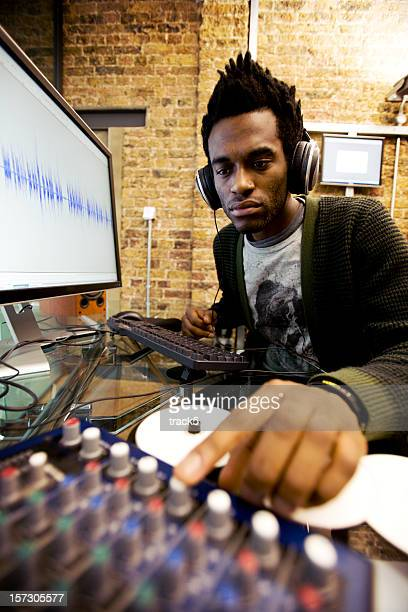 African man mixing audio at computer