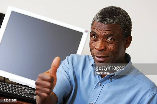 African Man on a Computer three