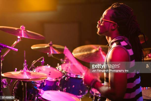 African man playing drums onstage